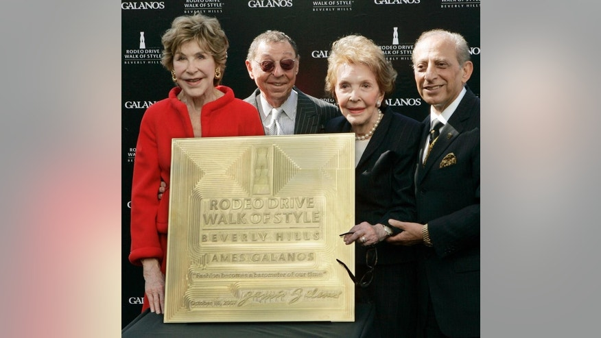 FILE - In this Oct. 18, 2007 file photo, celebrated fashion designer James Galanos, second from left, is joined by Betsy Bloomingdale, left, former first lady Nancy Reagan and Mayor Jimmy Delshad, as Galanos is honored with the Rodeo Drive Walk of Style Award in Beverly Hills, Calif. Betsy Bloomingdale, the widow of a department store heir who hobnobbed with the world's elite and was best friends with Nancy Reagan, has died. She was 93. Her daughter-in-law says Bloomingdale died Tuesday, July 19, 2016, at her Los Angeles home from congestive heart failure. (AP Photo/Reed Saxon, File)