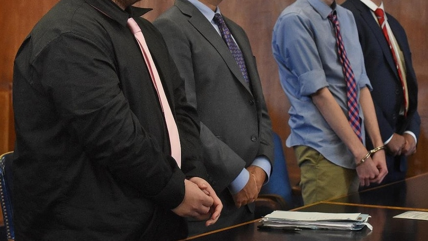 James Stumbo, from left, attorney Steve Goldwyn, Kevin Norton and attorney Robert LeRoy during a change of plea and sentencing for Stumbo and Norton, accused of bringing guns and ammunition to Boston after allegedly making online threats against the Pokemon World Championships, inside Suffolk Superior Court in Boston on Thursday, July 21, 2016. (Patrick Whittemore/The Boston Herald via AP, Pool)