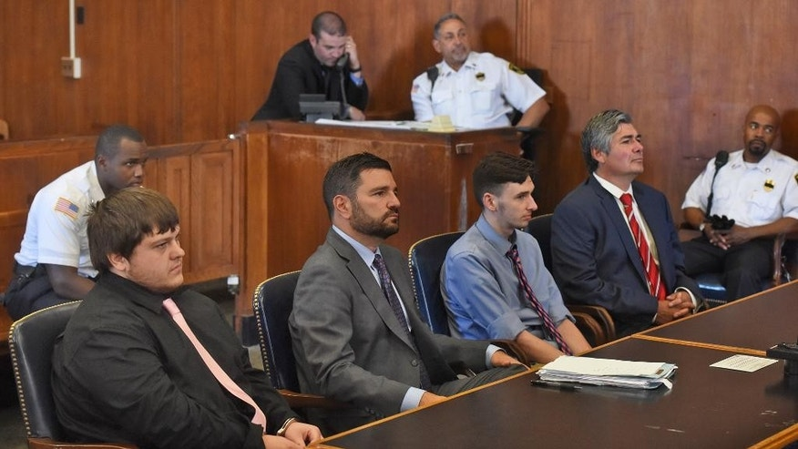 James Stumbo, from left, attorney Steve Goldwyn, Kevin Norton and attorney Robert LeRoy stand during a change of plea and sentencing for Stumbo and Norton, accused of bringing guns and ammunition to Boston after allegedly making online threats against the Pokemon World Championships, inside Suffolk Superior Court in Boston on Thursday, July 21, 2016. (Patrick Whittemore/The Boston Herald via AP, Pool)