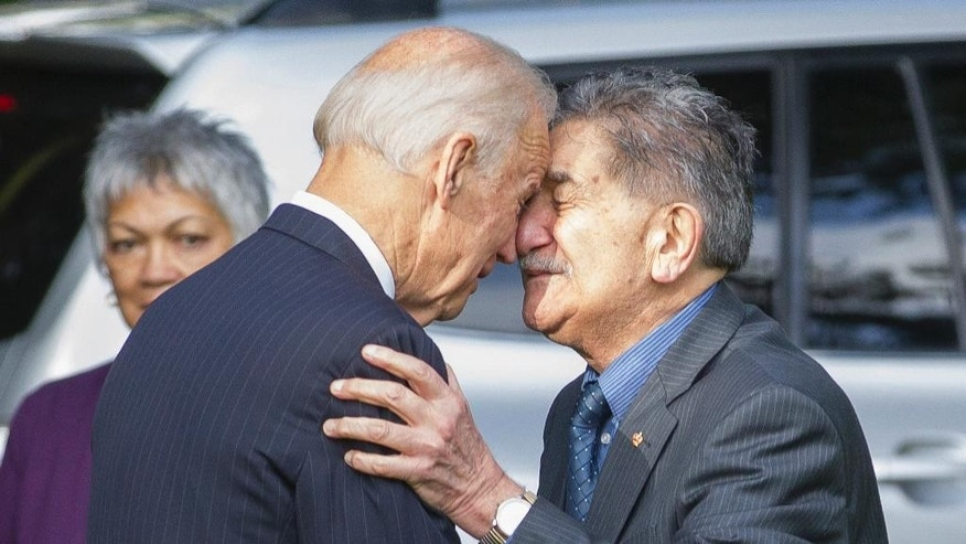 U.S. Vice President Joe Biden, left, shears a Maori welcome at Government House in Auckland Thursday, July 21, 2016. (Greg Bowker/New Zealand Herald via AP)