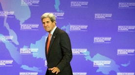 Secretary of State John Kerry arrives at a news conference at the conclusion of the Meeting of the Ministers of the Global Coalition to Counter ISIL at the State Department in Washington, Thursday, July 21, 2016. (AP Photo/Cliff Owen)