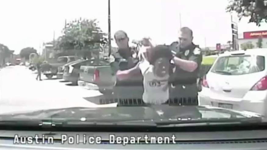 "In this June 15, 2015, frame from dash cam video, Breaion King is led by officers during a traffic stop in Austin, Texas. The black Texas teacher who was thrown to the ground by a white officer during the traffic stop, and then told by another white officer on the way to jail that blacks have ""violent tendencies,"" said Friday, July 22, 2016, she is grateful the police chief has publicly apologized. The footage released July 21, of the arrest is the latest in a string of videos showing tense encounters between police and blacks across the country. (Austin Police Department via AP)"