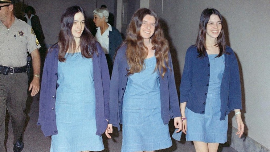 "FILE - In this Aug. 20, 1970 file photo, Charles Manson followers, from left: Susan Atkins, Patricia Krenwinkel and Leslie Van Houten, walk to court to appear for their roles in the 1969 cult killings of seven people, including pregnant actress Sharon Tate, in Los Angeles, Calif. California Gov. Jerry Brown is denying parole for Van Houten, the youngest follower of murderous cult leader Charles Manson. The Democratic governor said Friday, July 22, 2016, Van Houten's ""inability to explain her willing participation in such horrific violence"" leads him to believe she remains an unreasonable risk to society. (AP Photo/George Brich, File)"