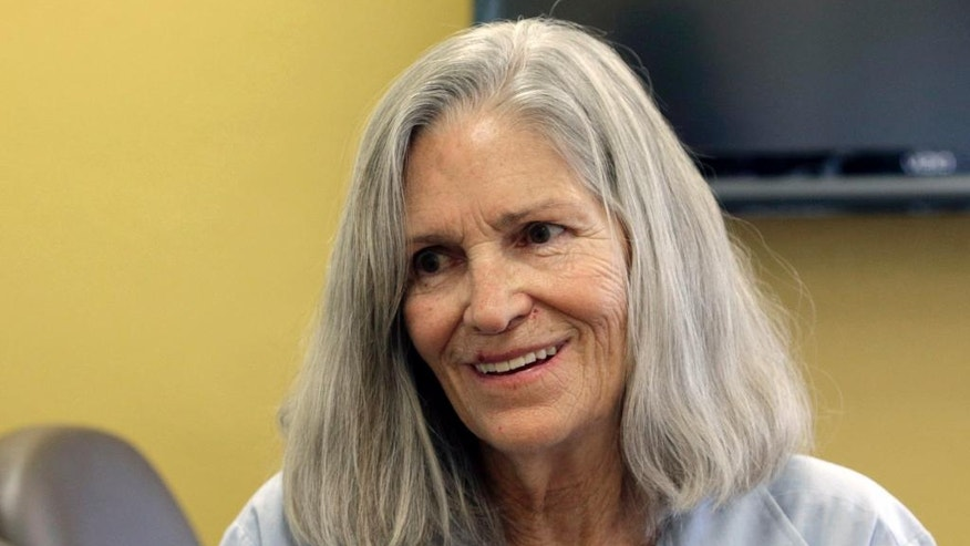 "FILE - In this April 14, 2016 file photo, former Charles Manson follower Leslie Van Houten confers with her attorney Rich Pfeiffer, not shown, during a break from her hearing before the California Board of Parole Hearings at the California Institution for Women in Chino, Calif. California Gov. Jerry Brown is denying parole for Van Houten, the youngest follower of murderous cult leader Charles Manson. The Democratic governor said Friday, July 22, 2016, Van Houten's ""inability to explain her willing participation in such horrific violence"" leads him to believe she remains an unreasonable risk to society. (AP Photo/Nick Ut, File)"