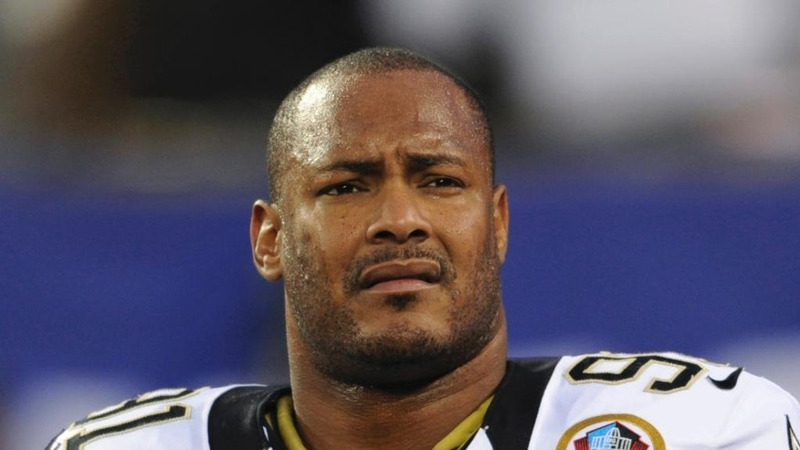 FILE - In this Dec. 9, 2012, file photo, New Orleans Saints defensive end Will Smith appears before an NFL football game against the New York Giants in East Rutherford, N.J. A judge in New Orleans postponed until Friday, July 22, 2016, a hearing on whether the New Orleans district attorney's office should be barred from prosecuting the man charged in the shooting death of Smith. (AP Photo/Bill Kostroun, File)