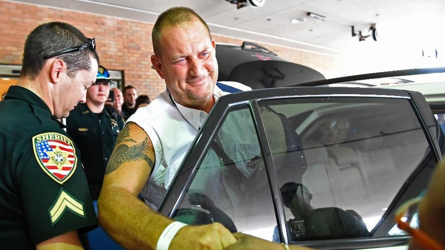 Twenty-three-year veteran East Baton Rouge Parish Sheriff's Sgt. Bruce Simmons, 51, leaves the Baton Rouge General Hospital in Louisiana on Thursday, July 21, 2016, after recovering from wounds received during an attack on officers on Sunday. (Bill Feig/The Advocate via AP)