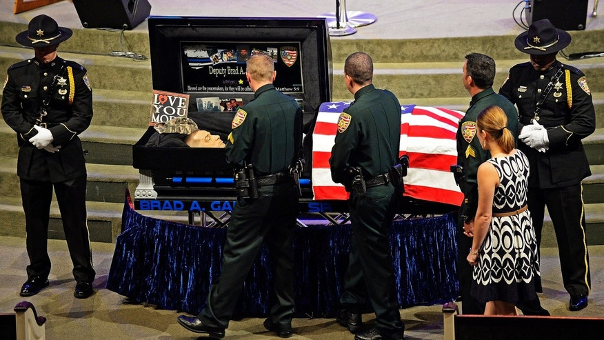 July 23, 2016: Mourners line up to view the body of East Baton Rouge Sheriff deputy Brad Garafola at the Istrouma Baptist Church in Baton Rouge, La.