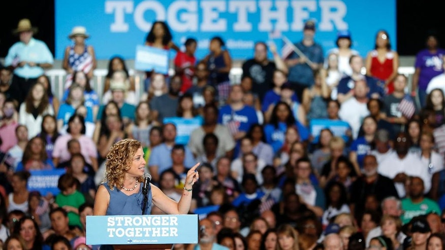 DNC chairwoman, Rep. Debbie Wasserman Schultz speaks during a campaign event for Democratic presidential candidate Hillary Clinton at the Florida State Fairgrounds Entertainment Hall, Friday, July 22, 2016, in Tampa, Fla. (AP Photo/Mary Altaffer)