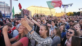 Young people react , during a concert organized for the participants of the World Youth Day to be held next week, in Warsaw, Poland, Thursday, July 21, 2016. The gathering of hundreds of thousands of young people from around the world will be attended by Pope Francis, and was initiated in the 1980s by Polish-born Pope John Paul II, who was declared a saint in 2014. (AP Photo/Czarek Sokolowski)
