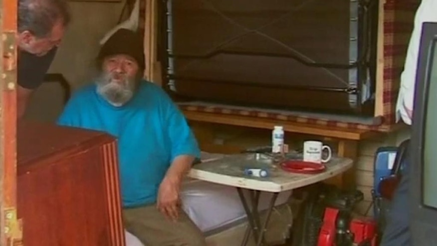 In this frame grab from a July 19, 2016 video, provided by WABC-TV in New York, David McLellan, an 81-year-old Navy veteran and retired auto plant worker, sits on a bed as he is questioned after being discovered in a Highlands, N.Y., motel room where authorities say he was held hostage for four years by a man who stole his benefit checks. Last Tuesday, police arrested his 43-year-old neighbor at the motel where both men lived and charged the man with grand larceny, menacing and endangering the welfare of an incompetent person, and veterans' organizations have since reached out to help McLellan, a Korean War-era veteran who had shown signs of dementia. (WABC-TV in New York via AP)