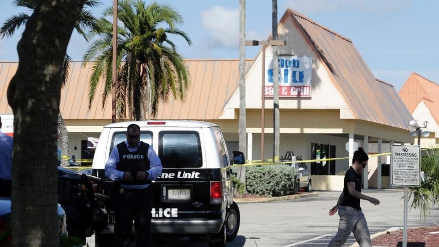 Officials investigate the scene of a deadly shooting outside the Club Blu nightclub, Monday, July 25, 2016, in Fort Myers, Fla. Gunfire erupted at the nightclub hosting a swimsuit-themed party for teens.  (AP Photo/Lynne Sladky)