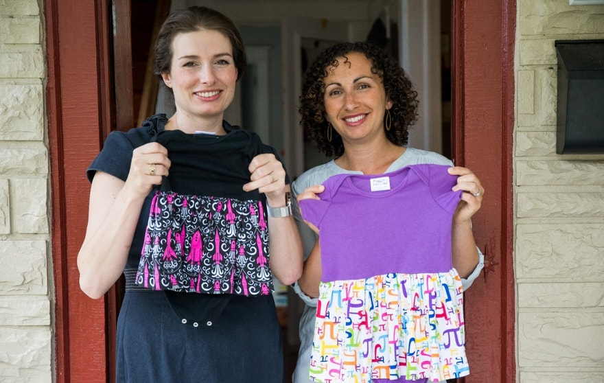 In this Tuesday, July 19, 2016, photo, Eva St. Clair, left, and Rebecca Melsky pose for a portrait at Melsky's home in Washington. Melsky and St. Clair design dresses for Princess Awesome, a girls' clothing line that uses traditional boys' motifs such as trains, dinosaurs, ninjas, and planes. (AP Photo/Zach Gibson)