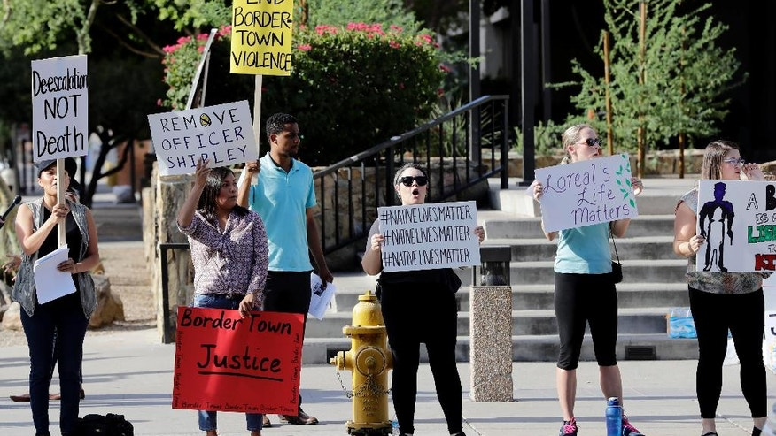 """Protesters stand outside Maricopa County Attorney Bill Montgomery's office, Monday, July 25, 2016, in Phoenix. No charges will be filed against a Winslow, Ariz. police officer in the shooting death of a woman four months ago, authorities announced Friday. Maricopa County Attorney Bill Montgomery announced his office """"found no evidence of criminal conduct"""" on the part of Officer Austin Shipley """"after a careful review of the facts surrounding this case including available video evidence and witness statements."""" (AP Photo/Matt York)"""