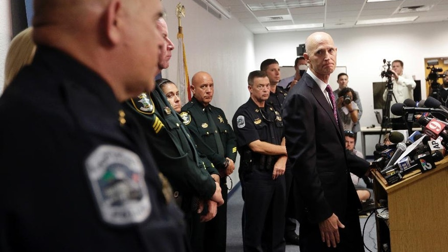 Florida Gov. Rick Scott responds to a question at a news conference in response to a deadly shooting outside the Club Blu nightclub in Fort Myers, Fla., Monday, July 25, 2016. Police said the gunfire, which erupted at a swimsuit-themed party for teens, was not an act of terrorism. (AP Photo/Lynne Sladky)
