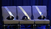 Three chairs honoring the slain Baton Rouge police officers are seen on stage before a memorial service at Healing Place Church in Baton Rouge, Louisiana, U.S. July 28, 2016.  REUTERS/Jonathan Bachman     TPX IMAGES OF THE DAY      - RTSK4OP