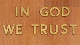 """In God We Trust"" is inscribed above the judge's chair in Part 31, Room 1333 of the New York State Supreme Court, Criminal Term at 100 Centre Street, in New York, February 3, 2012.  REUTERS/Chip East (UNITED STATES - Tags: CRIME LAW) - RTR2XT0U"