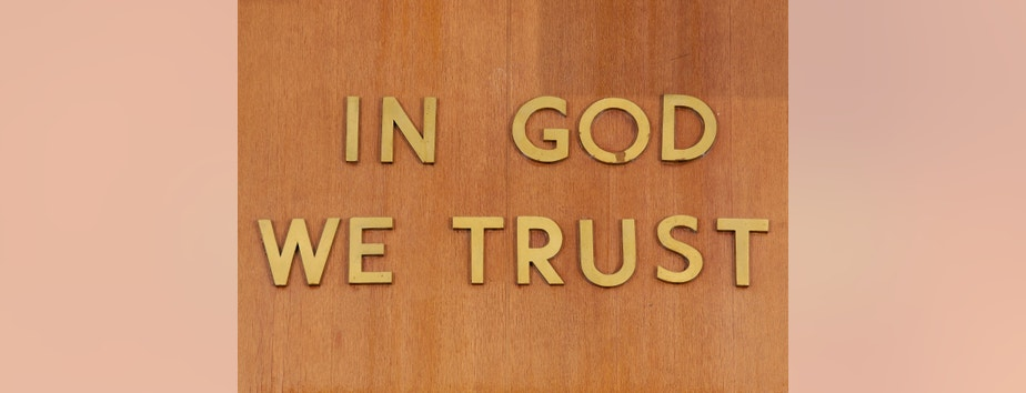"""""""In God We Trust"""" is inscribed above the judge's chair in Part 31, Room 1333 of the New York State Supreme Court, Criminal Term at 100 Centre Street, in New York, February 3, 2012.  REUTERS/Chip East (UNITED STATES - Tags: CRIME LAW) - RTR2XT0U"""