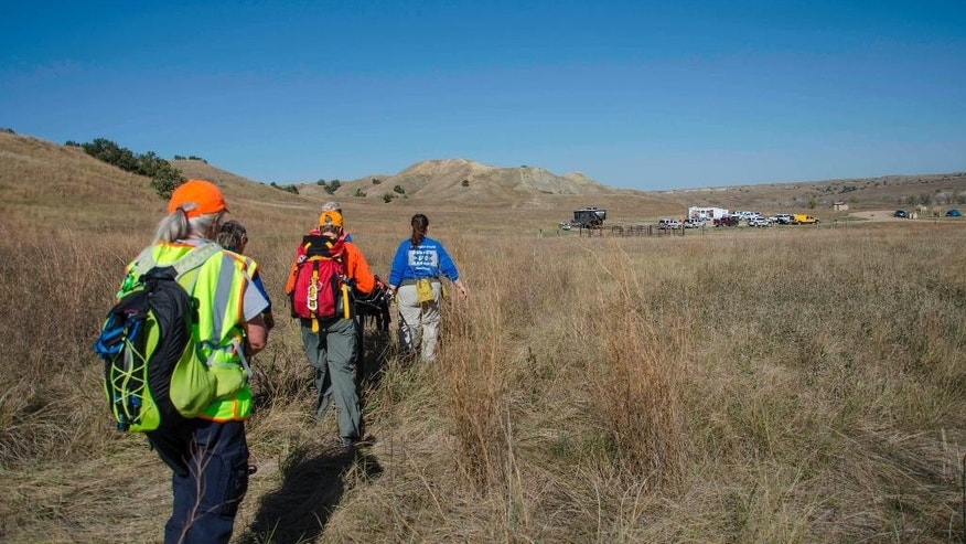 This October 2015 photo provided by Patty Garland shows a search-and-rescue exercise taking place in Badlands National Park, S.D., near the campsite where two hikers from Vermont were staying when they went missing Wednesday night, July 27, 2016. The 23 and 24-year-old women texted a friend Wednesday night saying they were lost, the Pennington County Sheriff's Office said. Authorities suspended the search about 2 a.m. Thursday and resumed it around four hours later. (Patty Garland via AP)