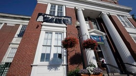 """FILE- In this July 21, 2016, file photo, a """"Black Lives Matter"""" banner hangs at the main entrance of City Hall in Somerville, Mass. Somerville Mayor Joseph Curtatone, a Democrat who is white, said Wednesday, July 27, that standing up for minority residents and supporting police officers aren't """"competing interests."""" Curtaton says he won't remove the banner even as police officers from across the state intend to rally against it. (AP Photo/Steven Senne, File)"""