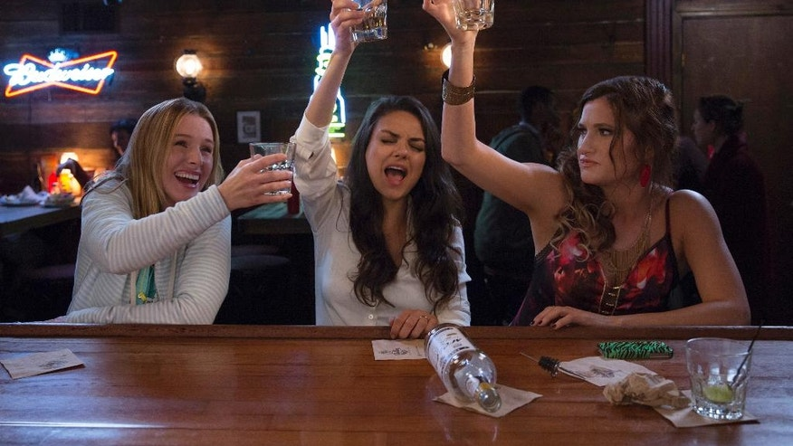 "This image released by STX Productions shows, from left, Kristen Bell, Mila Kunis and Kathryn Hahn in a scene from, ""Bad Moms."" (Michele K. Short/STX Productions via AP)"