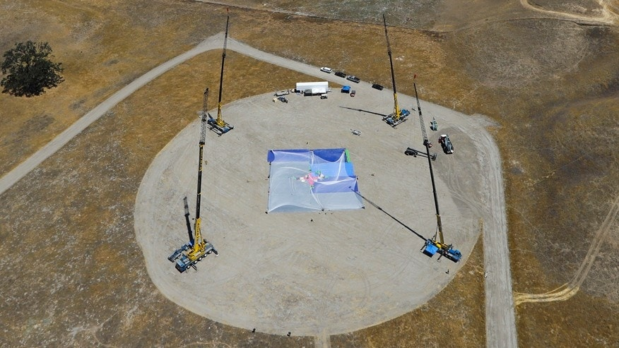 July 25, 2016: Cranes stand on the ground as production crew members set up a net about one-third the size of a football field and 20 stories high ahead of skydiver Luke Aikins' landing attempt without a parachute or wing suit in Simi Valley, Calif.