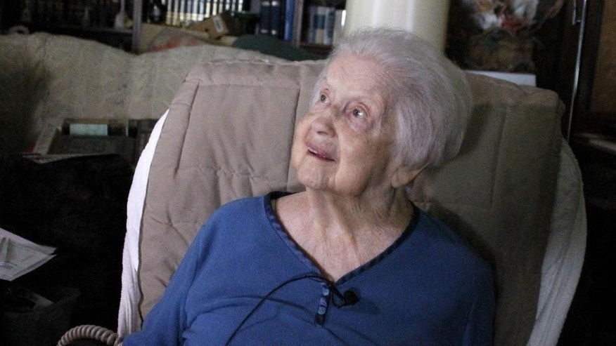 Alberta Morris, 86, talks to a reporter in her home in Reidsville, N.C., Friday, July 29, 2016. Morris lived across the street from William Claybourne Taylor, a fugitive who was arrested Thursday in connection with shootings in 1977 in Florida that killed a former immigration official and wounded the mayor of a Florida town. Taylor lived in Reidsville with his wife under an assumed name. (AP Photo/Skip Foreman)