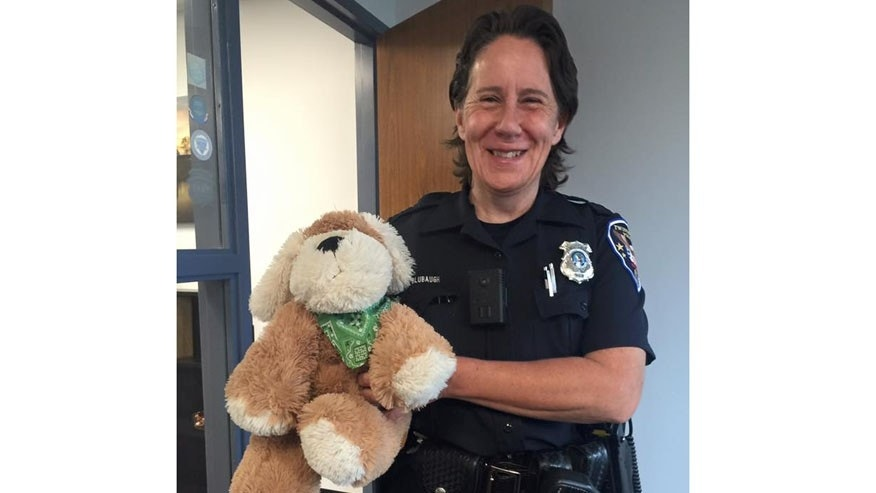 Twinsburg Police Officer April Blubaugh and Peanut. (Twinsburg Police Department)