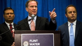 Attorney General Bill Schuette announces six more state employees are charged in connection to the Flint water crisis on Friday, July 29, 2016 at University of Michigan-Flint in downtown Flint.    (Jake May/The Flint Journal-MLive.com via AP)
