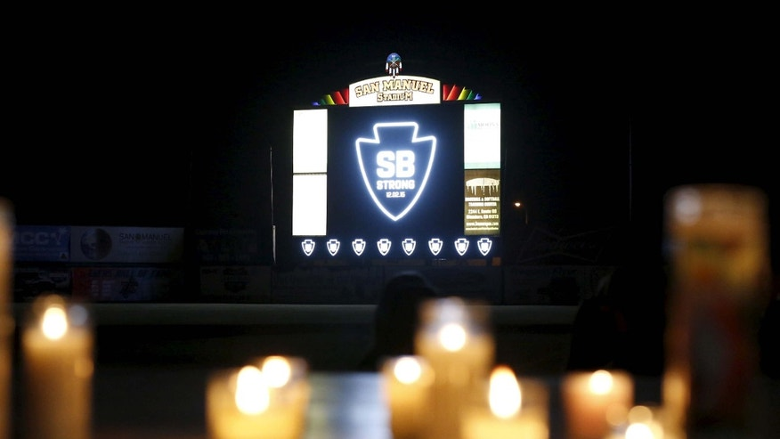 "Dec. 3, 2015: A sign reads ""SB Strong"", referring to Wednesday's attack during a candlelight vigil in San Bernardino, Calif."