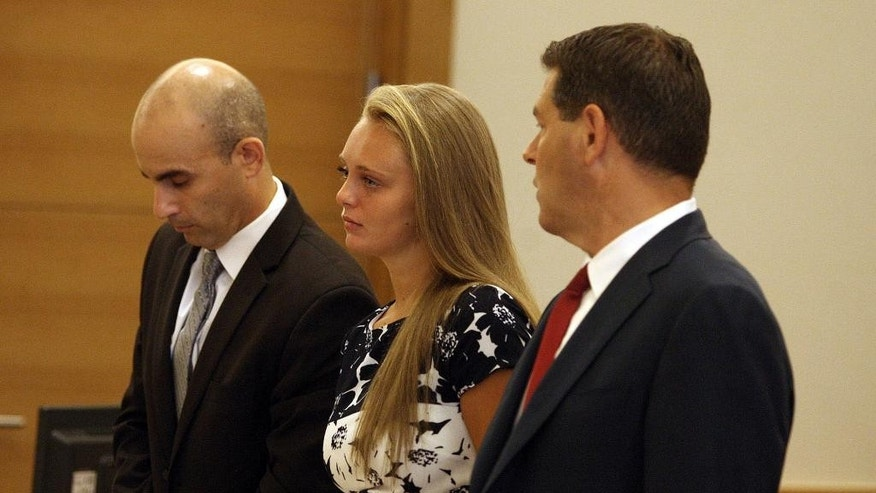 Michelle Carter, center, is shown at the Bristol County Juvenile Court in Taunton, Mass., Friday, July 29, 2016.  Lawyers for Carter, charged with involuntary manslaughter for sending her boyfriend text messages encouraging him to take his own life, have asked a judge to suppress statements she made to police. (George Rizer/The Globe via AP, Pool)