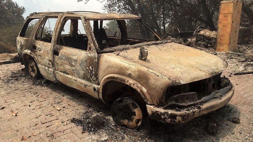 July 29, 2016: A car destroyed from wildfires sits in Big Sur, Calif.