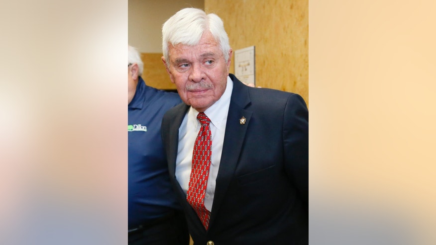 FILE - In this Friday, July 15, 2016 file photo, former Tulsa County Sheriff Stanley Glanz, leaves a Tulsa County courtroom in Tulsa, Okla. An Oklahoma volunteer sheriff's deputy program halted after a member fatally shot an unarmed black man during Glanz's time as sheriff, is back with tougher requirements, the new county sheriff says. (AP Photo/Sue Ogrocki, File)