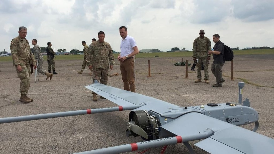 "U.S Army Secretary Eric Fanning, center, watches an unmanned aerial vehicle (UAV) during an annual joint military exercise with the Malaysian army in Johore Bahru, Malaysia, Saturday, July 30, 2016. Fanning says annual war games between the United States and South Korea will go ahead next month, despite North Korea's warning of a ""vicious"" showdown if the military drills proceed. (AP Photo/Eileen Ng)"