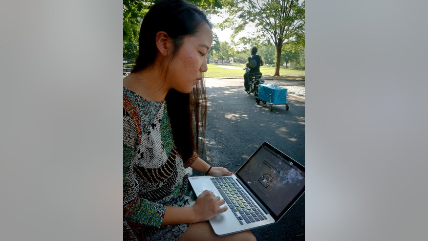 In this Thursday July 21, 2016 photo, Korean American Jaime Sunwoo shows, from her laptop, a social media collaboration letter written by a host of Asian Americans and translated for their communities to discuss and support the Black Lives Matter movement, in New York. Some Asian and Latino supporters of the Black Lives Matter movement are reaching out to others in their communities to convince them that the movement is their fight too.(AP Photo/Bebeto Matthews)
