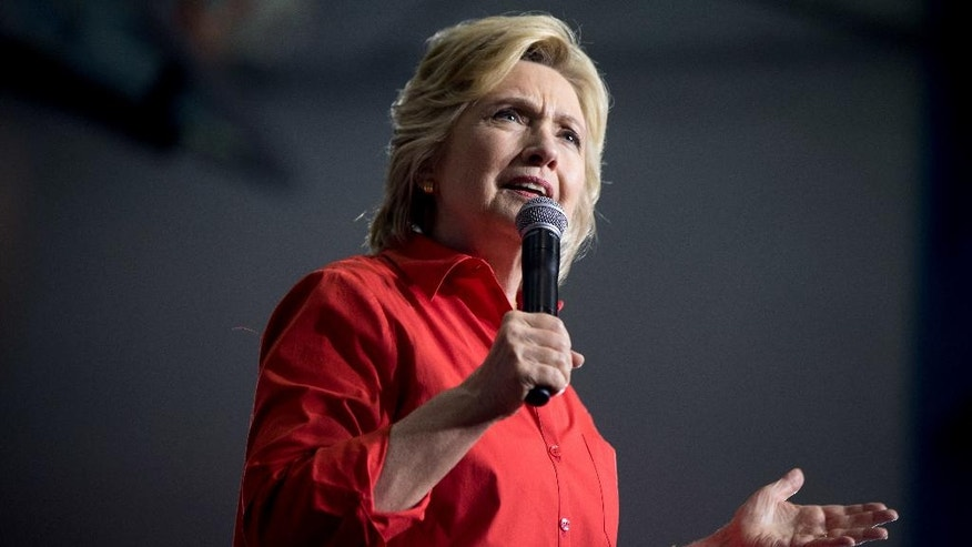 Democratic presidential candidate Hillary Clinton speaks at an event at East High School in Youngstown, Ohio, Saturday, July 30, 2016. Clinton and Democratic vice presidential candidate Sen. Tim Kaine, D-Va., are on a three day bus tour through the rust belt. (AP Photo/Andrew Harnik)