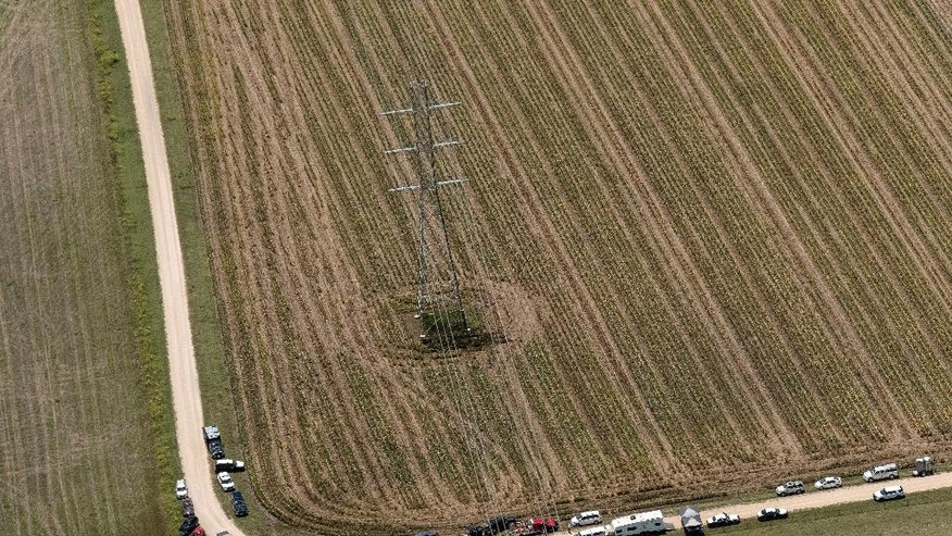 "In this aerial photo authorities investigate after a hot air balloon caught on fire and crashed in in Central Texas near Lockhart, Texas, Saturday, July 30, 2016, causing what authorities described as a ""significant loss of life."" (Rodolfo Gonzalez/Austin American-Statesman via AP)"