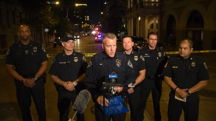 Austin Police Assistant Chief Brian Manley speaks during a press conference after gunshots rang out on Sixth Street just as the bars were emptying at closing time early Sunday, July 31, 2016, leaving one woman dead and several others wounded, and police searching for a suspect.  (Ricardo B.Brazziell/Austin American-Statesman via AP)