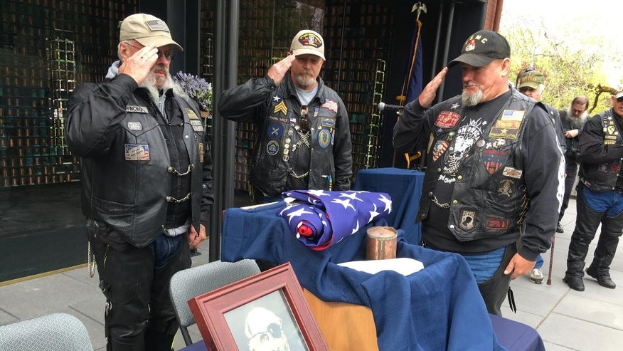 Patriot Guard Riders, from left to right, Steve West, Milt Harden and Dan Halverson salute the cremated remains of Maine Civil War soldier Jewett Williams in Salem, Ore., Monday, Aug. 1, 2016, before the ashes are handed over for a motorcycle journey across the country to Williams' home state where he will be buried with military honors. Williams served in the 20th Maine Regiment and died in 1922 at an Oregon insane asylum. (AP Photo/Andrew Selsky)