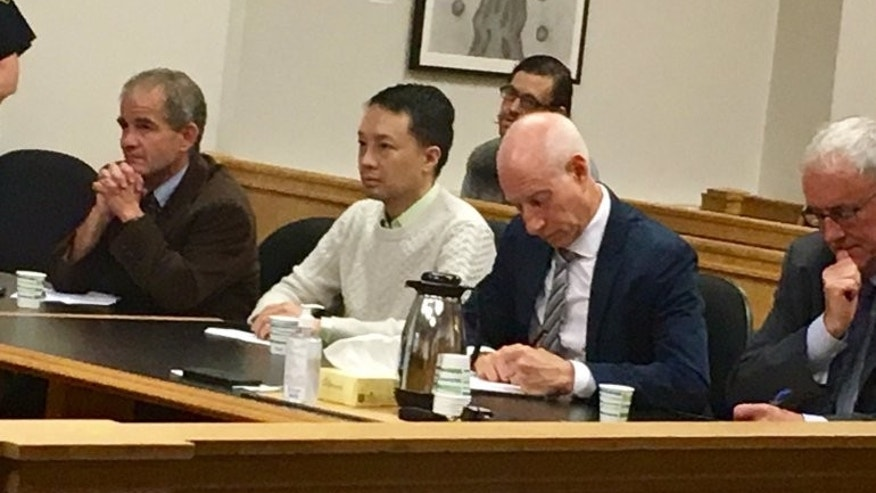 Louis Chen, center, in court.