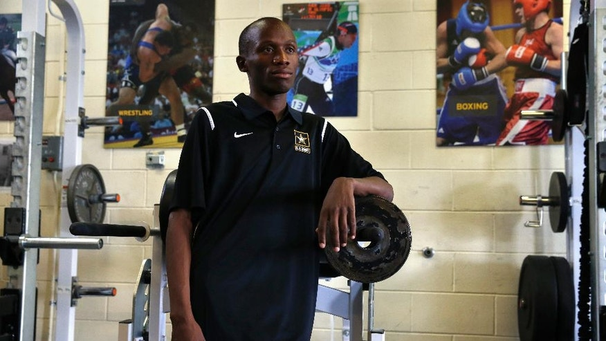 In this July 19, 2016 photo, Kenyan-born U.S. Army Sgt. Hillary Bor stands in the gym inside the U.S. Army's World Class Athlete Program, at Fort Carson Army Base, outside Colorado Springs, Colo. Bor and three other runners of Kenyan descent have taken a unique path to the Olympics through enlisting in the Army, earning U.S. citizenship, training with the military branch's World Class Athlete Program and making Team USA.  (AP Photo/Brennan Linsley)