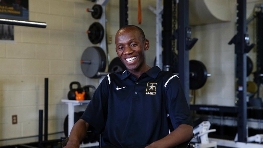 In this July 19, 2016 photo, Kenyan-born U.S. Army Sgt. Hillary Bor sits in the gym inside the U.S. Army's World Class Athlete Program, at Fort Carson Army Base, outside Colorado Springs, Colo. Bor and three other runners of Kenyan descent have taken a unique path to the Olympics through enlisting in the Army, earning U.S. citizenship, training with the military branch's World Class Athlete Program and making Team USA. (AP Photo/Brennan Linsley)