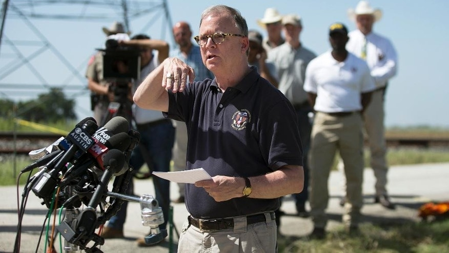National Transportation Safety Board (NTSB) member Robert Sumwalt speaks during a news conference at the scene of Saturday's hot air balloon crash near Lockhart. Texas, Monday, Aug. 1, 2016. Sixteen people died in the crash. (Deborah Cannon/Austin American-Statesman via AP)