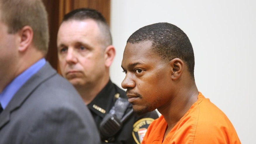 Charles Crawford, 24, looks out into the Clermont County Municipal courtroom during his arraignment in front of Magistrate Anita Bechmann. Crawford is charged with aggravated murder in the death of his four-month-old daughter, Kaylynn Crawford. His bond was set at $2 million. He first reported she had been abducted from his car while at the Dollar Store in Loveland Sunday evening. Monday, he led authorities to her body in the Little Miami River near Kelley Nature Preserve. (Liz Dufour /The Cincinnati Enquirer via AP)