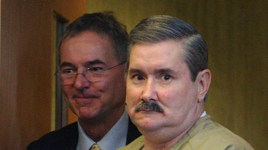 Leeland Eisenberg in court with his lawyer, Randy Hawkes, in Dover, N.H. in 2008.