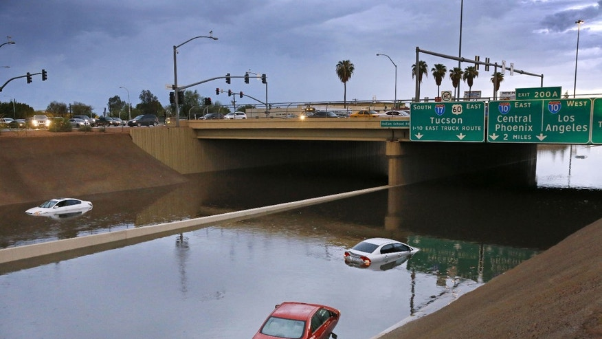 Cars sit stranded in Arizona flood waters.