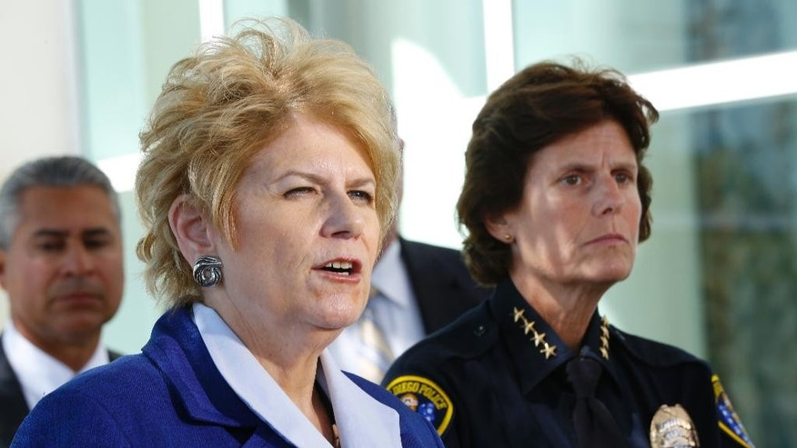 District Attorney Bonnie Dumanis and San Diego Police Chief Shelley Zimmerman address the news media following the arraignment of Jesse Gomez at UCSD Medical Center in San Diego, Calif., Tuesday, Aug. 2, 2016. Gomez — a construction worker with two felony convictions — pleaded not guilty to murder and attempted murder charges at a hospital where he is recovering from wounds sustained in the gunbattle with police. (Nelvin C. Cepeda/The San Diego Union-Tribune via AP)