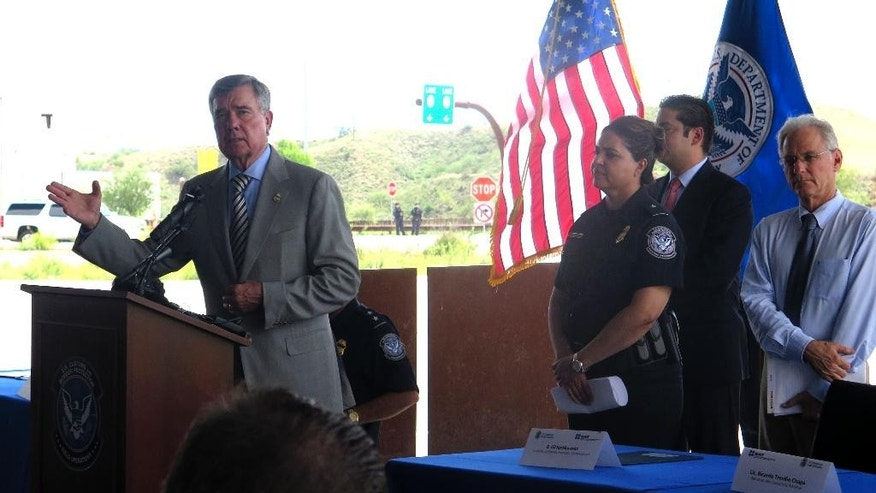 U.S. Customs and Border Protection Commissioner Gil Kerlikowske, left, speaks during an event in Nogales, Ariz., on Thursday, Aug. 4, 2016, promoting a new program that allows Mexican and American customs officers to jointly inspect cargo trucks headed north bound. Kerlikowske said the pilot program has already reduced wait times from two to three hours to 25 minutes in the week that the program has been used. Only select companies are allowed to participate. (AP Photo/Astrid Galv'n)