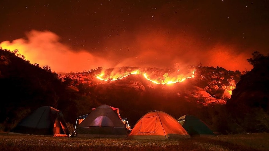 As campers bed down for the night along Putah Creek, the Cold fire burns slowly downhill.