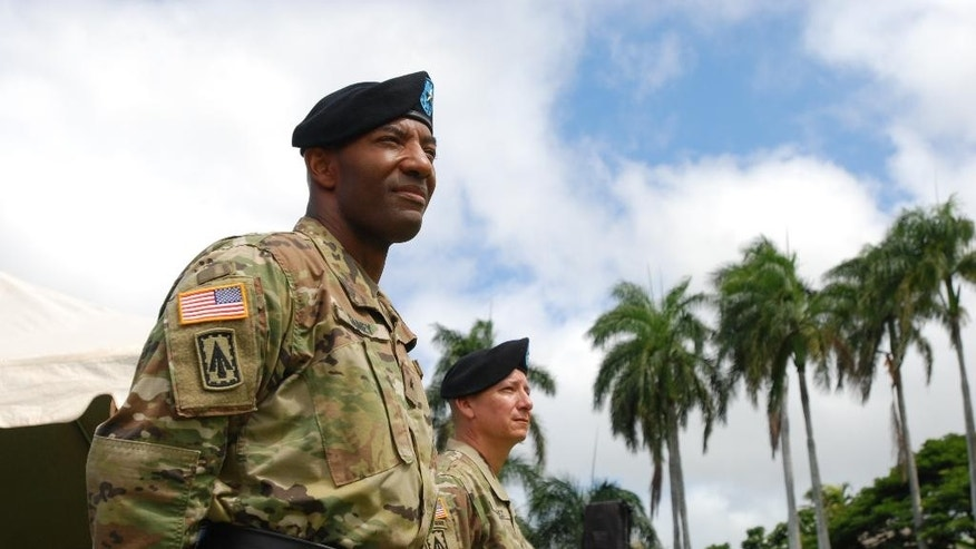 Brig. Gen. Sean Gainey, left, and Brig. Gen. Eric Sanchez stand during a change of command ceremony at Fort Shafter in Honolulu on Friday, Aug. 5, 2016. Gainey assumed command of the 94th Army Air and Missile Defense Command from Sanchez during a ceremony. (AP Photo/Audrey McAvoy)
