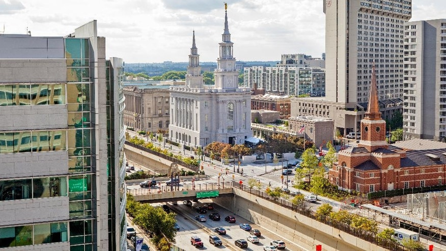 This Aug. 3, 2016 photo shows the new Mormon Temple, center, set to open near Logan Square in Center City in Philadelphia. The Mormon church is offering the general public a rare opportunity to tour its 152nd temple, a first of its kind in Pennsylvania.  Regional membership in The Church of Jesus Christ of Latter-day Saints has grown to more than 40,000 members in parts of Pennsylvania, Delaware, New Jersey and Maryland. The growth prompted church leadership in 2008 to announce the temple plans.  (AP Photo/Michael Sisak)